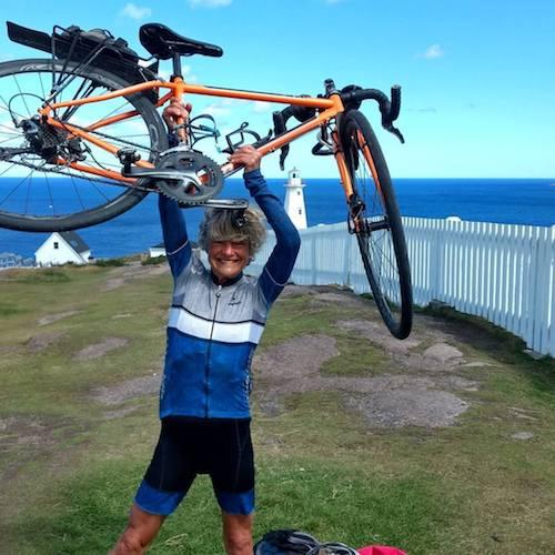 Jane with bike overhead