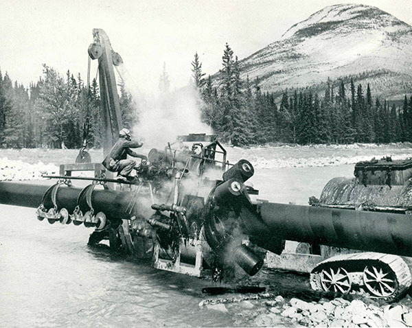 Wrapping machine during Trans Mountain construction in Alberta