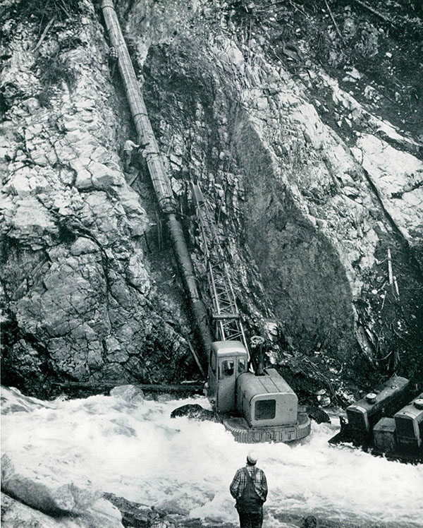 Pipe construction of original Trans Mountain line at Coquihalla Canyon