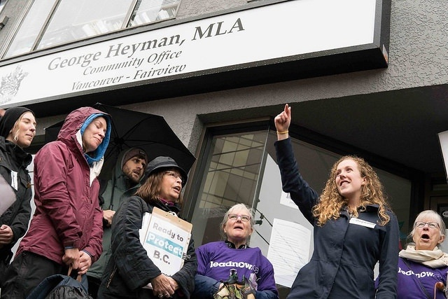 Dogwood's Sophie Harrison and volunteers in front of MLA George Heyman's office.